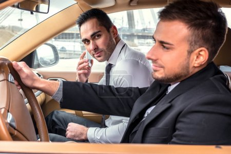 Two modern guys in the car