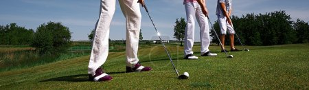 Three golf players