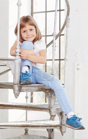 Cute little girl in denim jeans