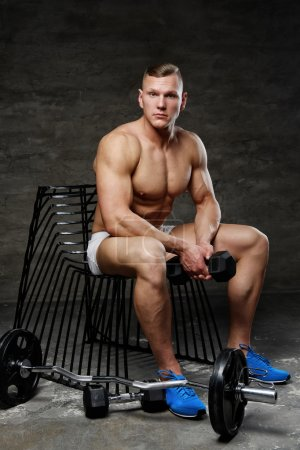 man posing in studio with barbell
