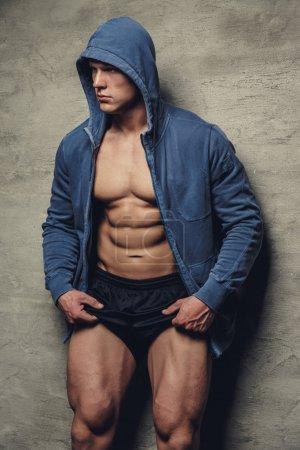 man in a blue hoodie