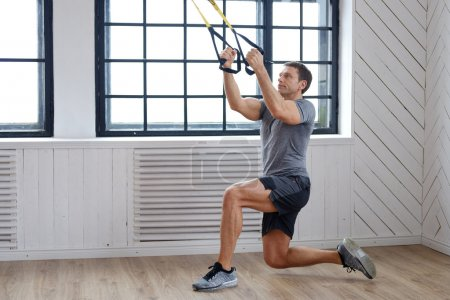 Man exercising with expanders