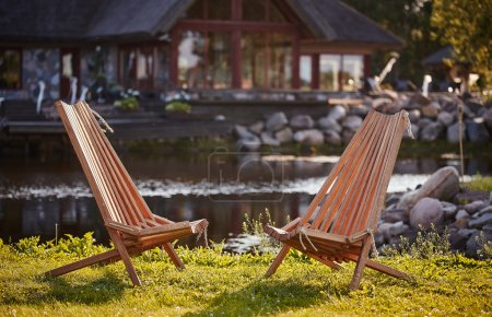 Two wooden chaise lounges