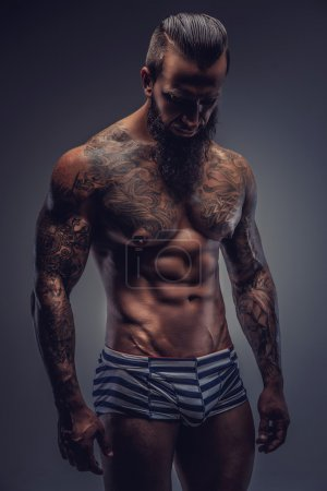 Naked man with tattooed body