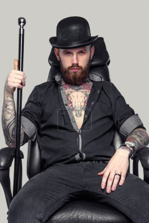 Bearded tattooed guy with walking stick