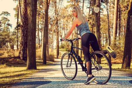 Sexy blond female on a bicycle