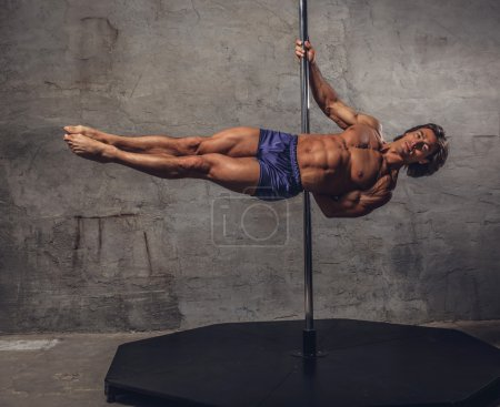 Shirtless man pole dancing