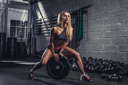 Blond female in a gym club