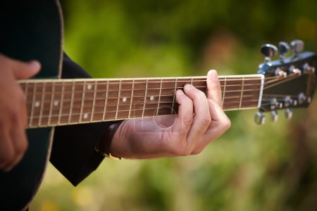 A man playing on guitar