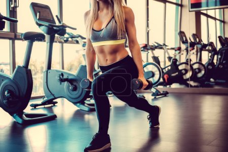 female doing workout with dumbbells