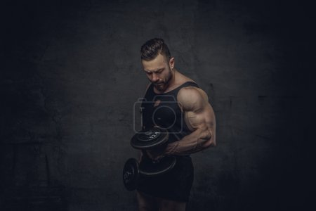Powerful huge bodybuilder with dumbbells