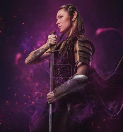 Elf woman holding sword
