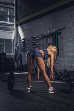fitness blond female from back