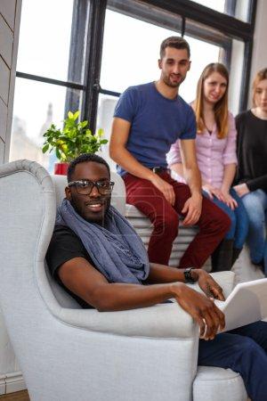 Multi ethnic students using laptop