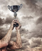 athlete holding trophy