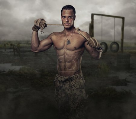Photo for Shirtless muscular soldier in a training swampland - Royalty Free Image