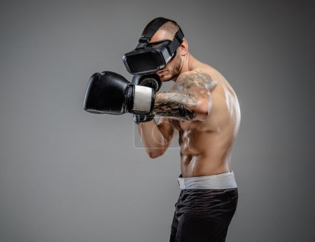 Boxing fighter in virtual reality glasses