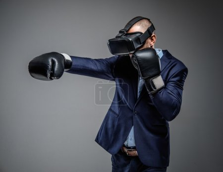 Male fighting with virtual reality glasses