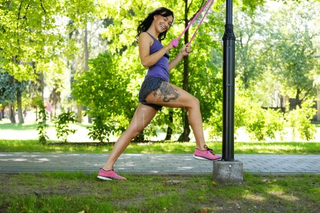 Female doing exercising with fitness trx