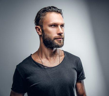 Fashionable modern male in grey t shirt