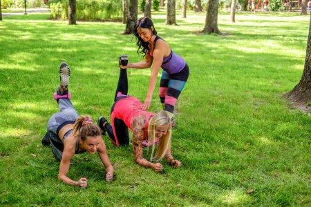 Three sporty women warming up