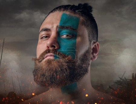 Scandinavian male warrior on a battlefield