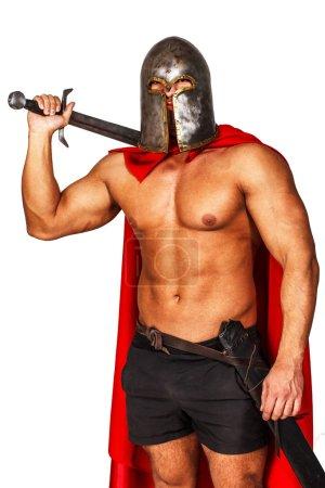 Photo pour Image de guerrier en casque et manteau - image libre de droit