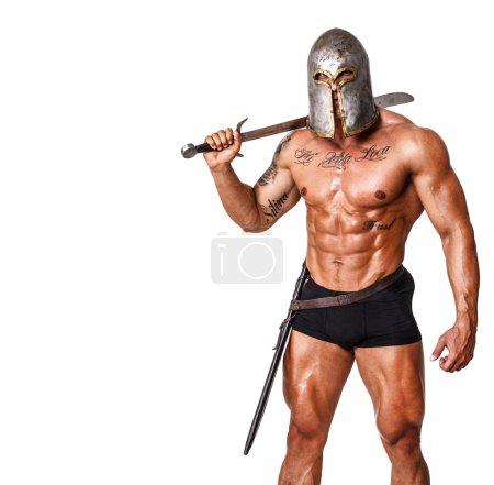 Photo pour Image de guerrier en pantalon et casque - image libre de droit