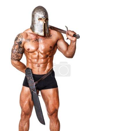 Photo pour Image de guerrier en pantalon et casque avec épée - image libre de droit