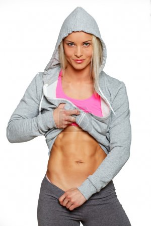 Cute blond woman with perfect abs