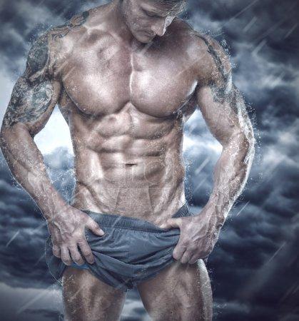 Muscular man showing his body