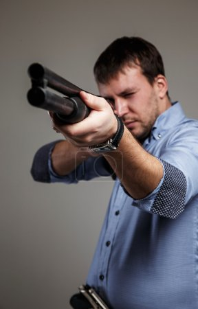 Male with shoot-gun