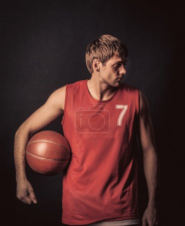 sportsman holding basketball ball