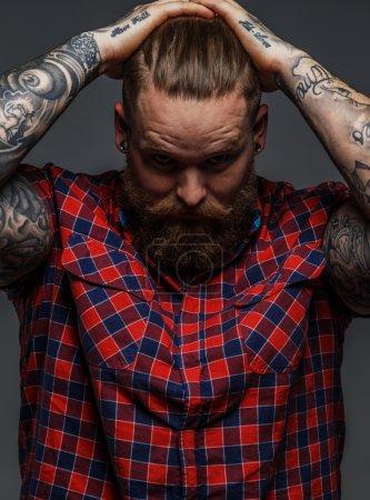 Brutal tattooed male with beard