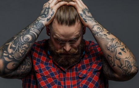 Brutal tattooed male with beard