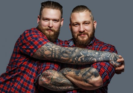 Two brutal males with tattooes and beards