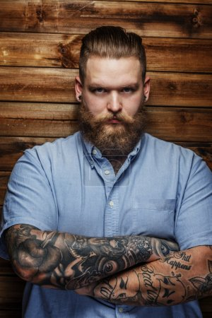 Huge male with beard and tattooes