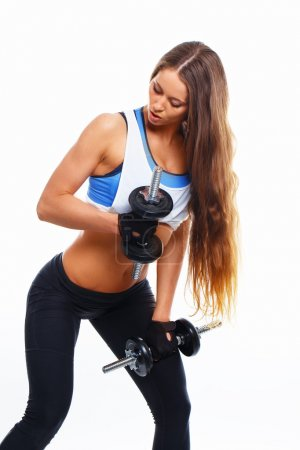 Fitness woman with dumbells on white background