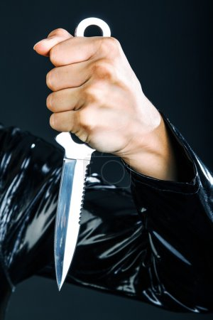 Womans arm with knife