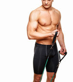 Fitness man doing exercises with expander