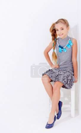 Photo for Young girl in a dress posing on white background - Royalty Free Image