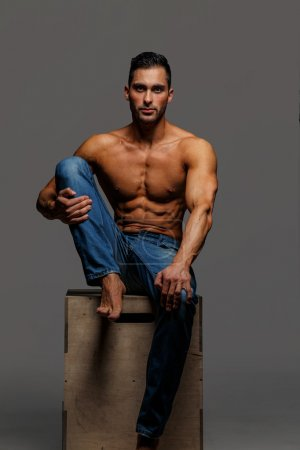 Attractive shirtless guy in blue jeans