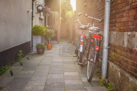 Two bycicles near stone wall