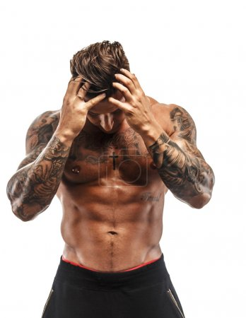 Awesome muscular man with tattoo