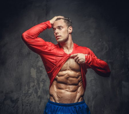 Muscular man in red t-shirt