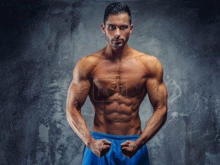 Shirtles fitness man in blue shorts