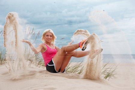 Smiling blond woman in sportswear