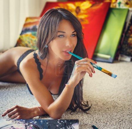 Portrait of brunette young woman in underwear.