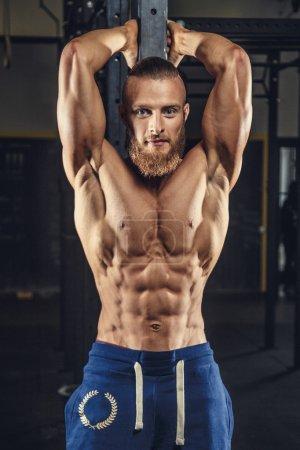 Shirtless muscular bodybuilder