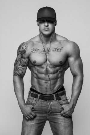 Black and white portrait of shirtless bodybuilder